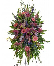 Pinks and purples featuring gerbera daisies, lilies, and roses