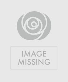 Lovely wreath on a stand bursting with color in shades of pink, purple and red