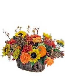 Wicker basket filled with beautiful fall flowers