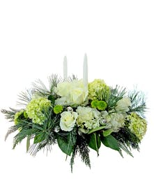 Centerpiece featuring white roses and white and green hydrangea