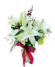 Beautiful white lilies featured with ilex and hydrangea