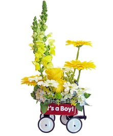A classic little red wagon filled with fresh cut flowers.