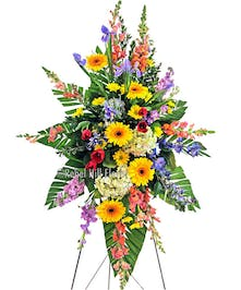 Beautiful and colorful sympathy spray on an easel