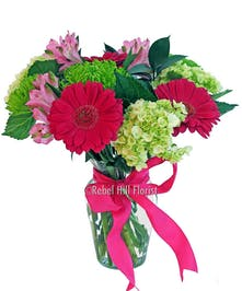 Popular arrangement of gerbera daisies, hydrangea, alstroemeria and fuji mums