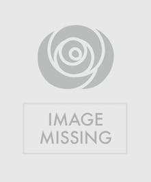 White flowers arranged in a blue vase with a patriotic ribbon