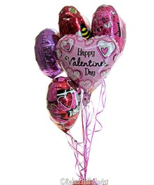 Balloon bouquet includes 6, 9, or 12 balloons anchored with a Colts Chocolates sampler